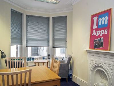 Managed office space London Mortimer Street break out area